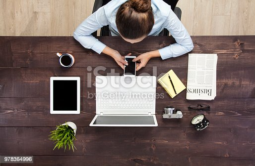 831932306 istock photo Businesswoman working at her desk 978364996