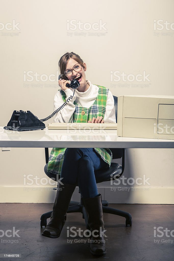Businesswoman working at her Desk Talking on Phone royalty-free stock photo