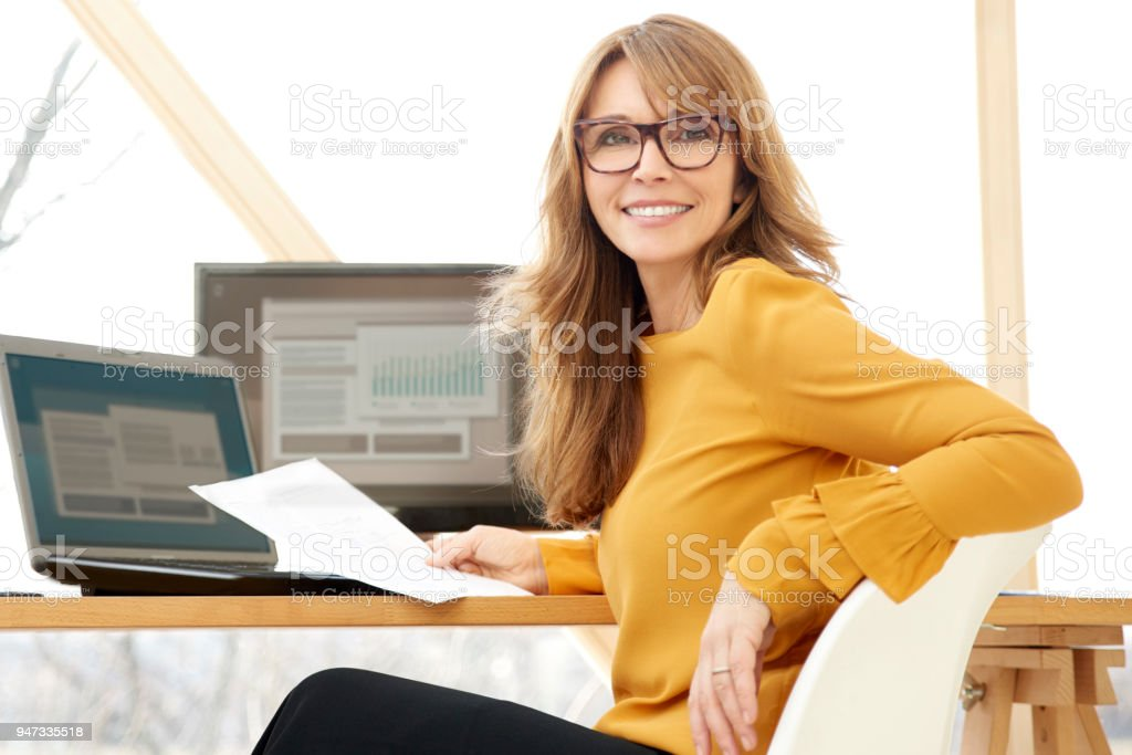 Businesswoman working at the office стоковое фото