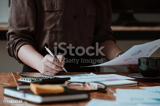 1158207931 istock photo businesswoman working data document graph chart report marketing research development planning management strategy analysis financial accounting. Business office concept 1174834244