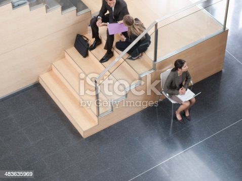 483635979 istock photo Businesswoman working in busy office corridor 483635969