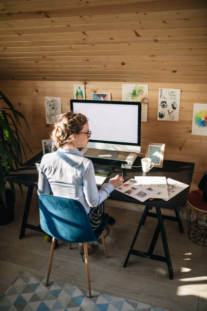Businesswoman Working In Creative Office stock photo