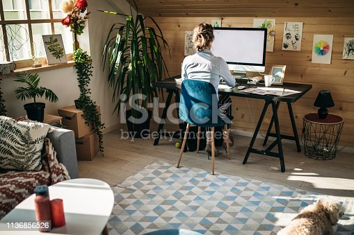Female Graphic Designer Working In Creative Office Studio