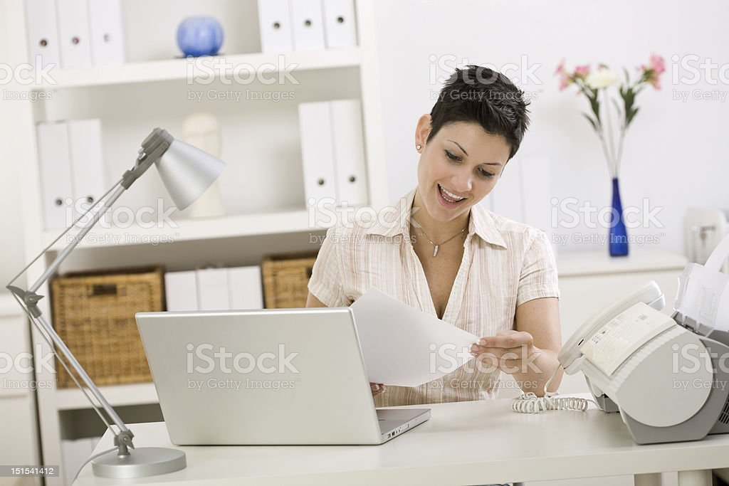 A businesswoman working in her home office stock photo