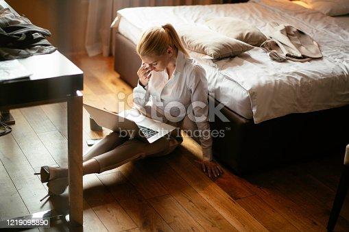 947825822 istock photo Businesswoman working in hotel room. 1219098890