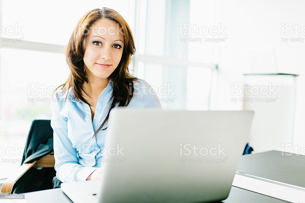 Businesswoman Working in Modern Office on Laptop PC royalty-free stock photo