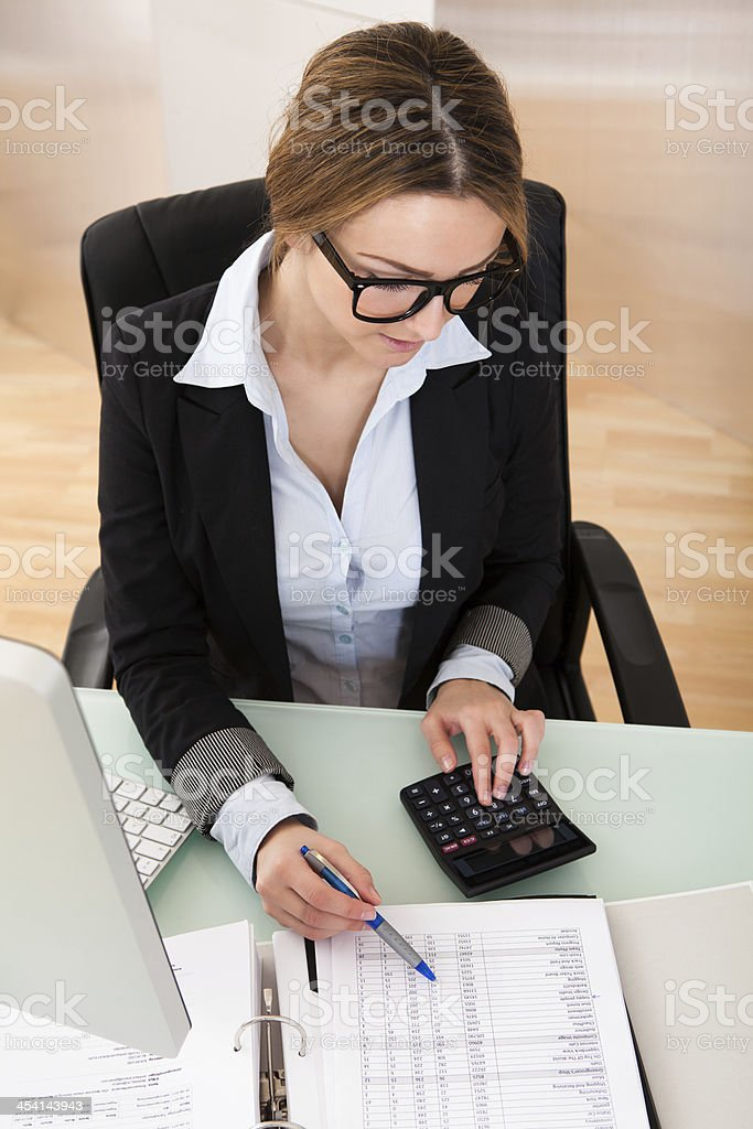 Businesswoman Working In Office royalty-free stock photo
