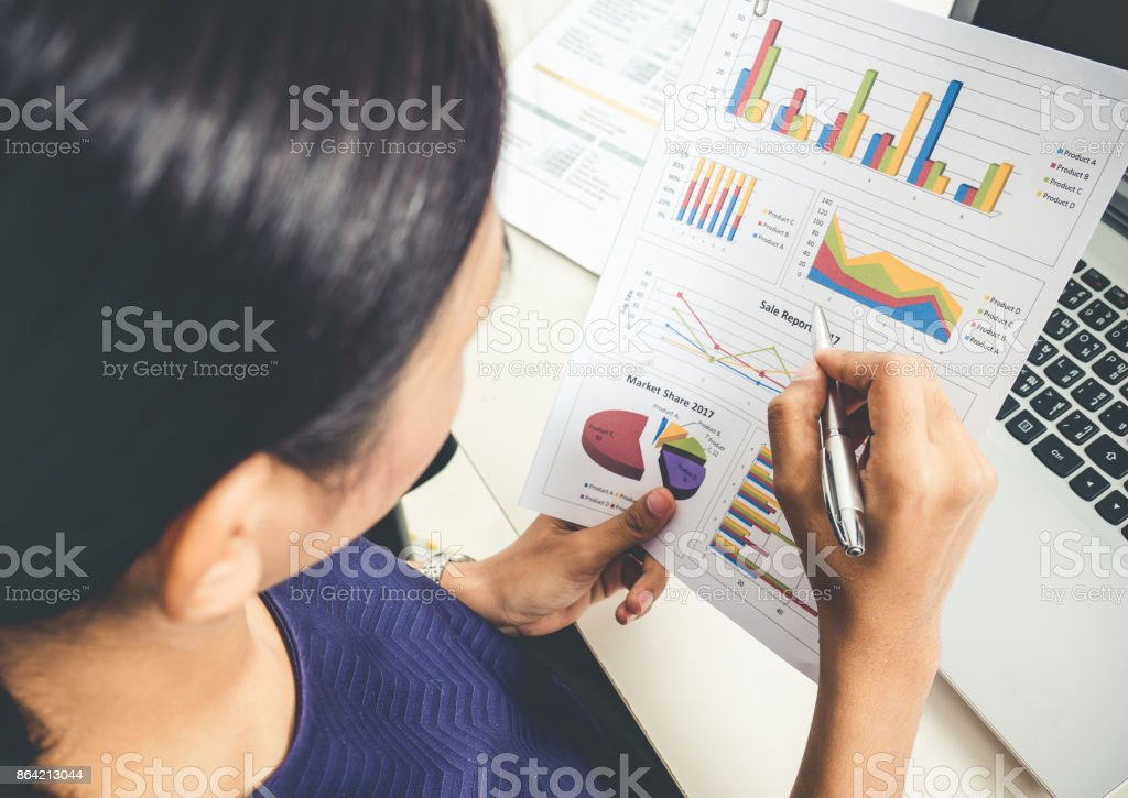 Businesswoman working in office, reading a financial report and documents during  business meeting, top view royalty-free stock photo