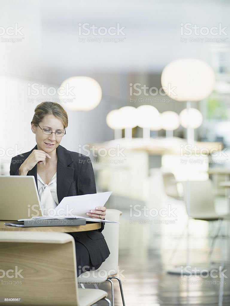 Businesswoman working in open plan office royalty-free stock photo