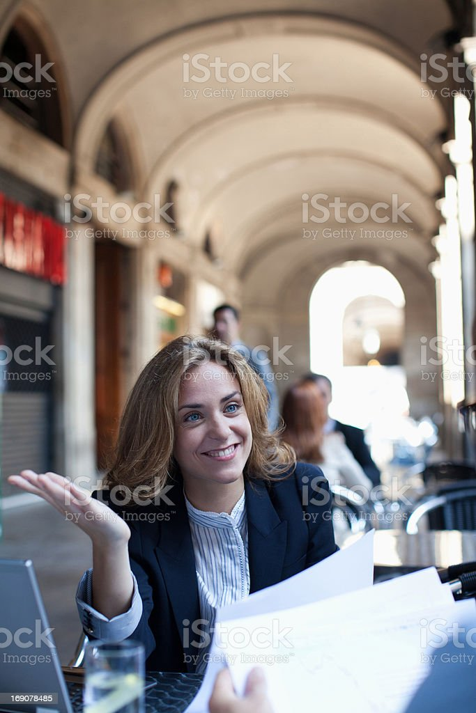 Businesswoman working in sidewalk cafe royalty-free stock photo