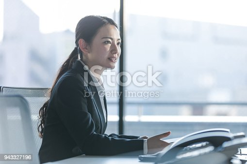 istock Businesswoman working in the office. Positive workplace concept. 943327196