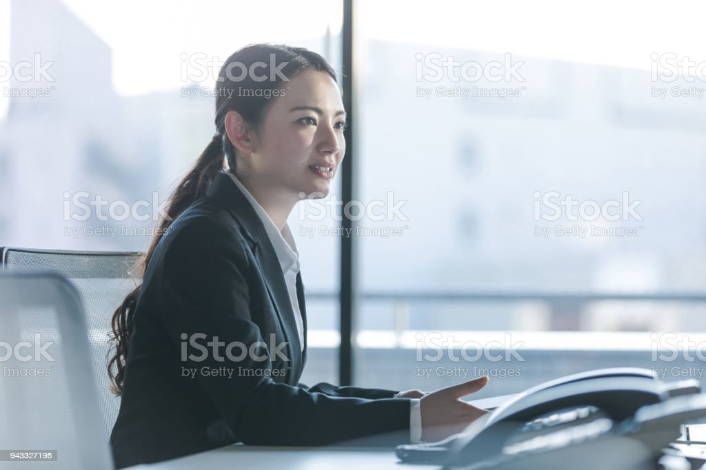 Businesswoman working in the office. Positive workplace concept. stock photo