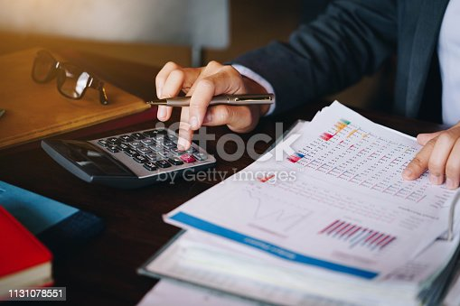 istock Businesswoman working in the office with calculator for financial data analyzing counting. Business financial analysis and strategy concept. 1131078551