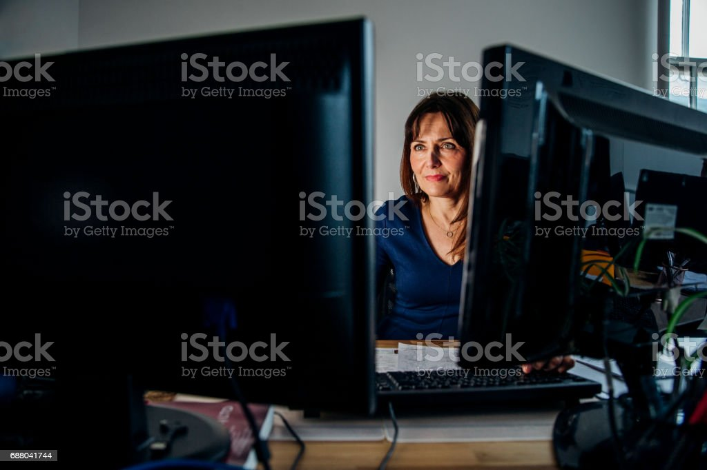 Businesswoman Working Late Again stock photo