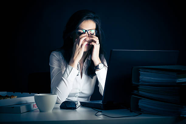 businesswoman working late stock photo