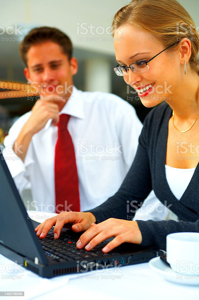 Businesswoman working on a laptop royalty-free stock photo