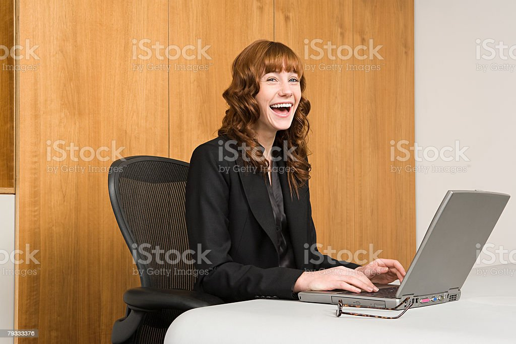 A businesswoman working on a laptop royalty-free stock photo