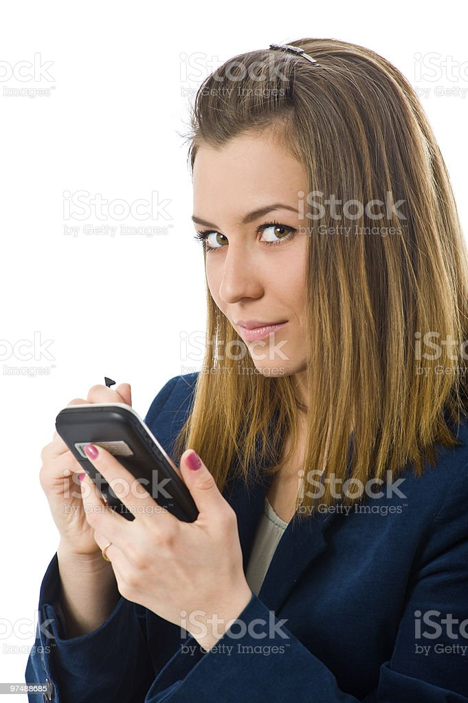 Businesswoman working on a mobile royalty-free stock photo