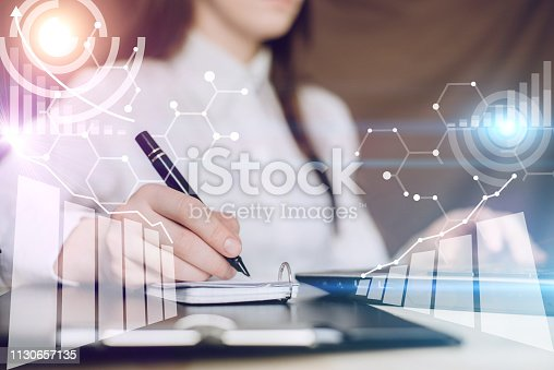 istock Businesswoman working on a project. Business data analysis technology, Key performance indicators and growth concept. 1130657135
