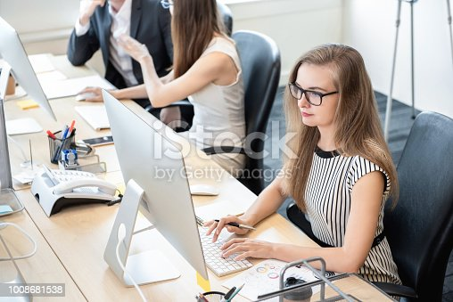 istock Businesswoman working on computer in the office 1008681538