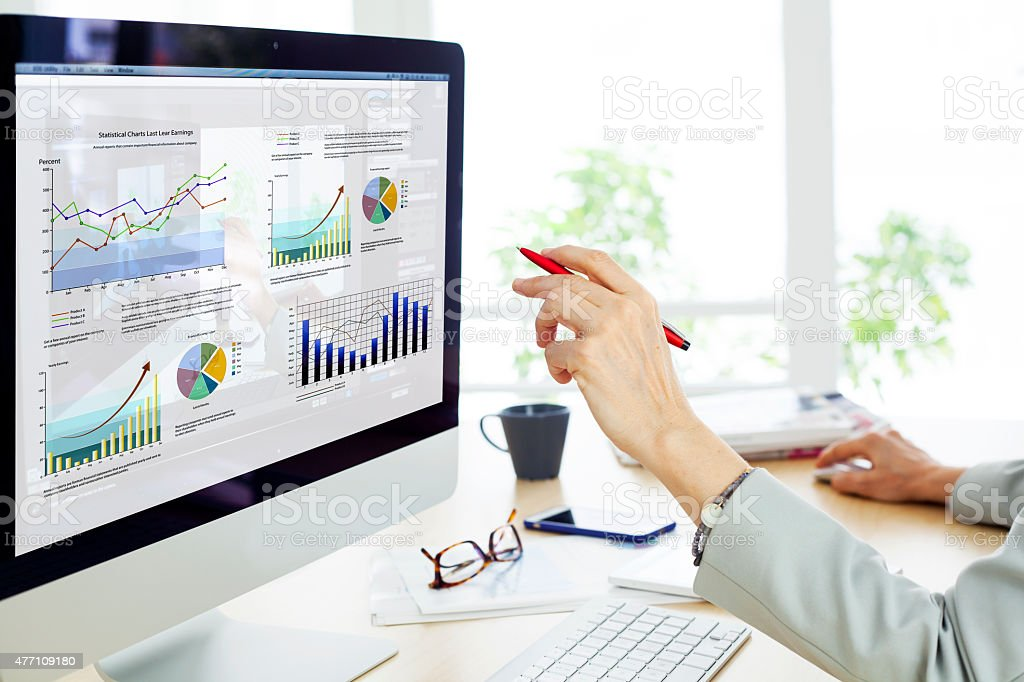 Businesswoman working on computer stock photo