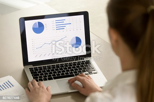 istock Businesswoman working on laptop, analyzing statistics, software for business analysis 827627446
