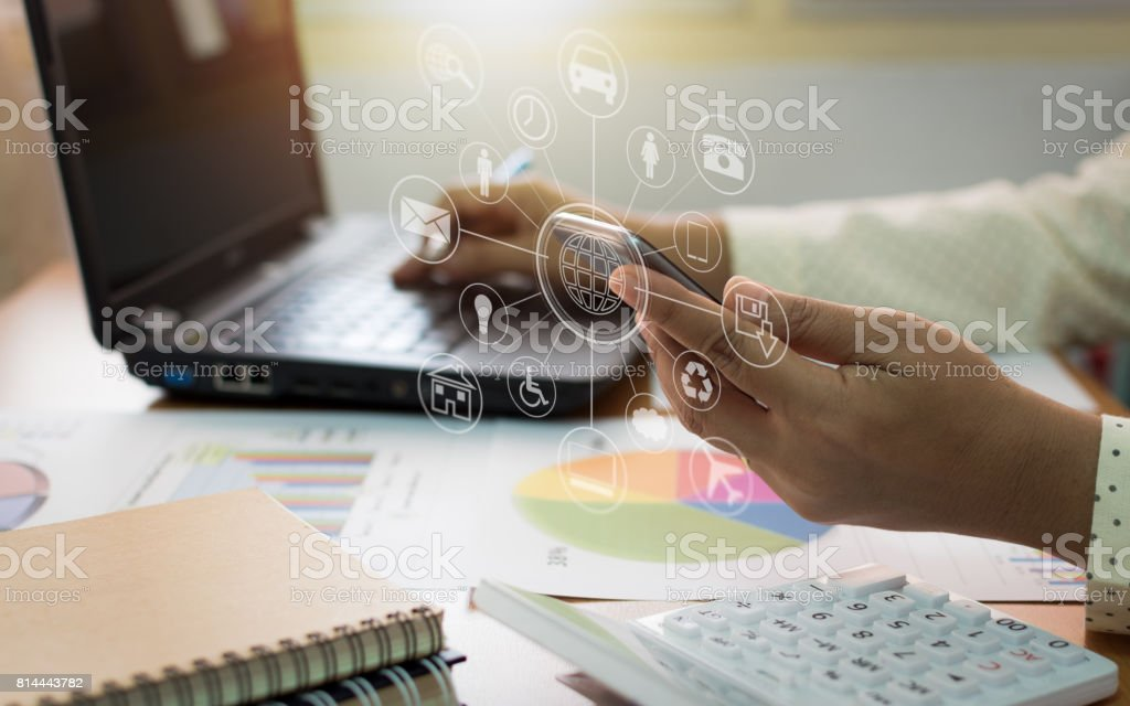 Businesswoman working on laptop and mobile phone. stock photo