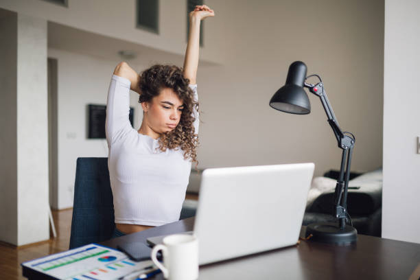 Businesswoman working on laptop stock photo