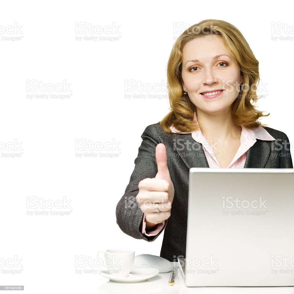 Businesswoman working on laptop royalty-free stock photo