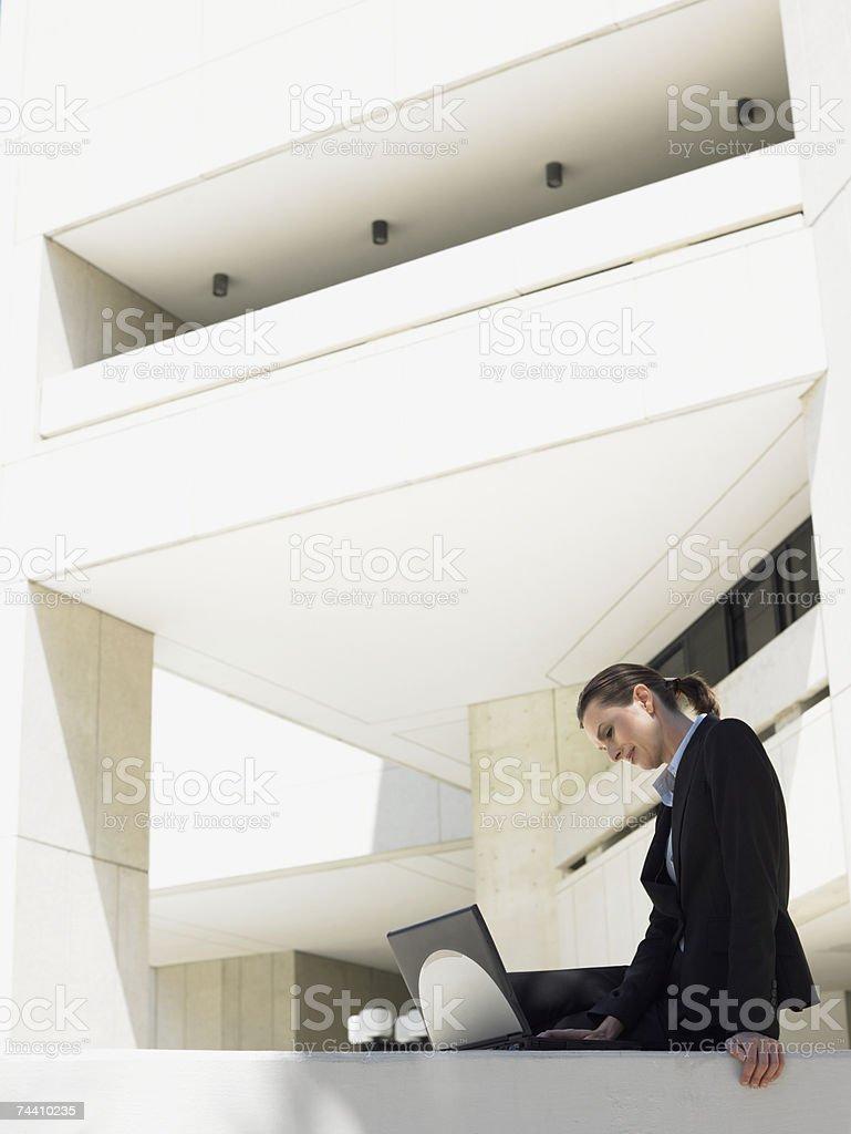 Businesswoman working on laptop royalty-free stock photo