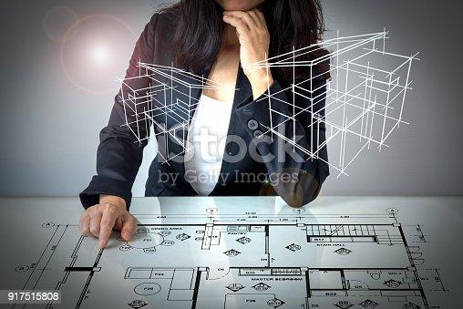 istock Businesswoman (Architect / Interior designer) working on modern futuristic virtual table 917515808