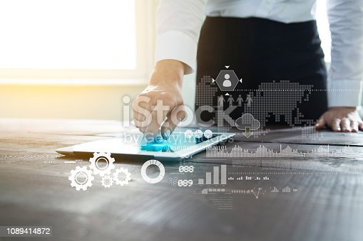 497982910 istock photo Businesswoman working using tablet pc 1089414872