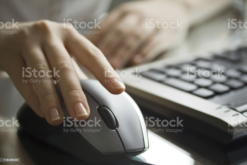 Businesswoman working with black computer mouse. royalty-free stock photo