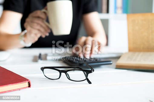 462138083 istock photo Businesswoman working with calculator in the office workplace 638698554