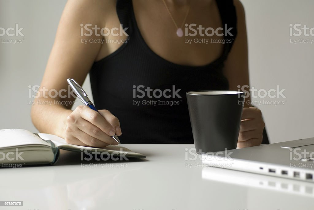Businesswoman Working with Laptop and Note pad royalty-free stock photo