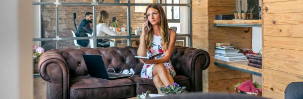 Businesswoman working with laptop talking on the phone sitting o picture id1248449281?b=1&k=6&m=1248449281&s=612x612&w=0&h=nt6otgudhbyxjxrefkd3uv3xpzdoglxp12nb1ymxxfi=
