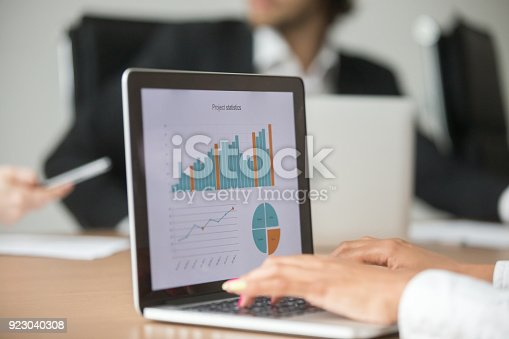 istock Businesswoman working with statistical report at team meeting analyzing data 923040308
