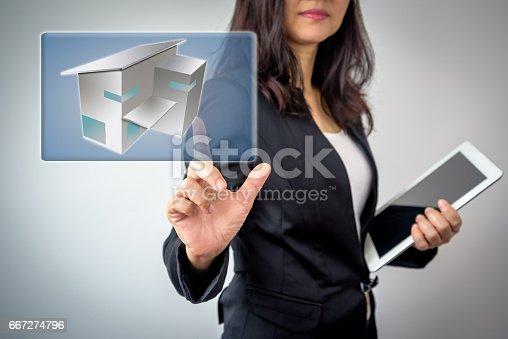 istock Businesswoman (Architect / Interior designer) working with virtual 3D home 667274796