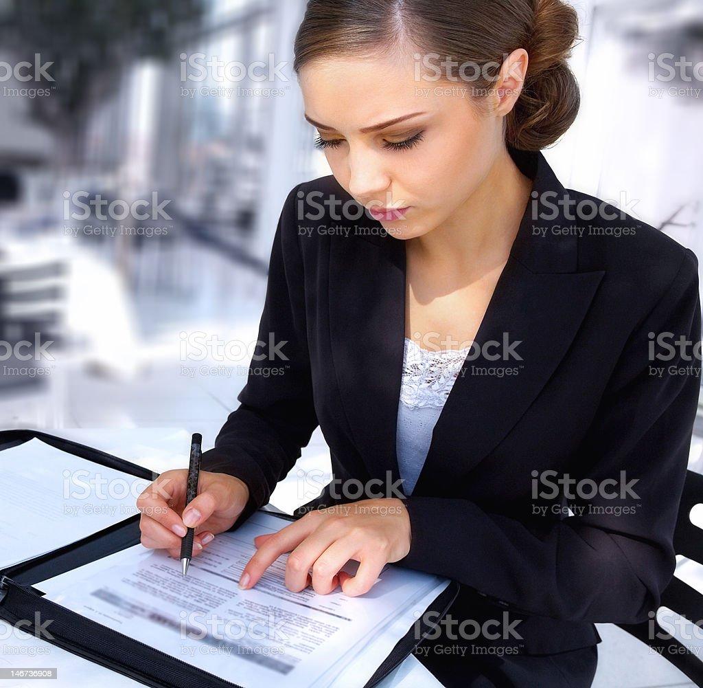 Businesswoman writing documents royalty-free stock photo