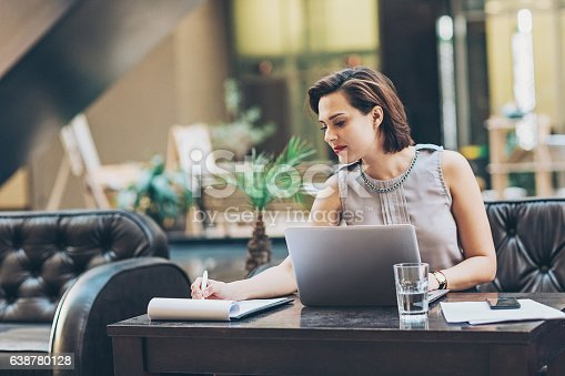 istock Businesswoman writing documents 638780128