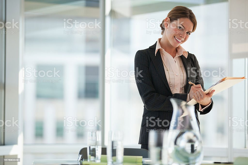 Businesswoman writing in office royalty-free stock photo