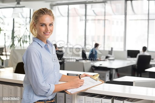 istock Businesswoman writing notes 539436852