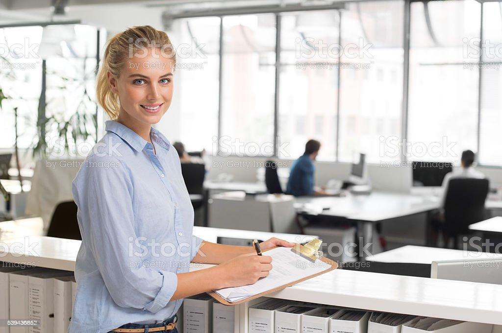 Businesswoman writing notes stock photo