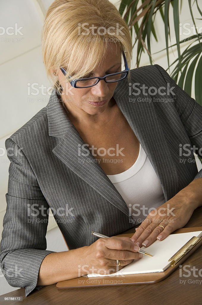 Businesswoman writing notes royalty-free stock photo