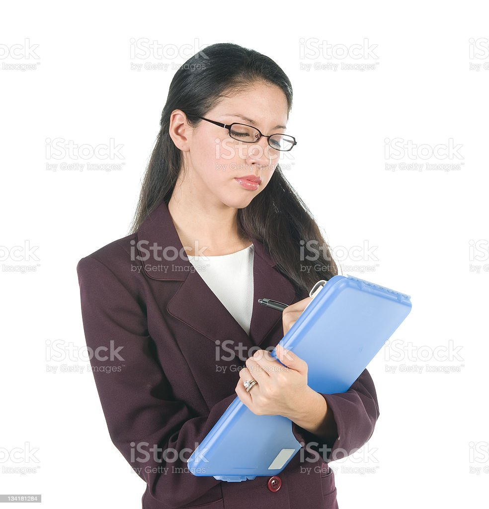 Businesswoman Writing on Clipboard stock photo