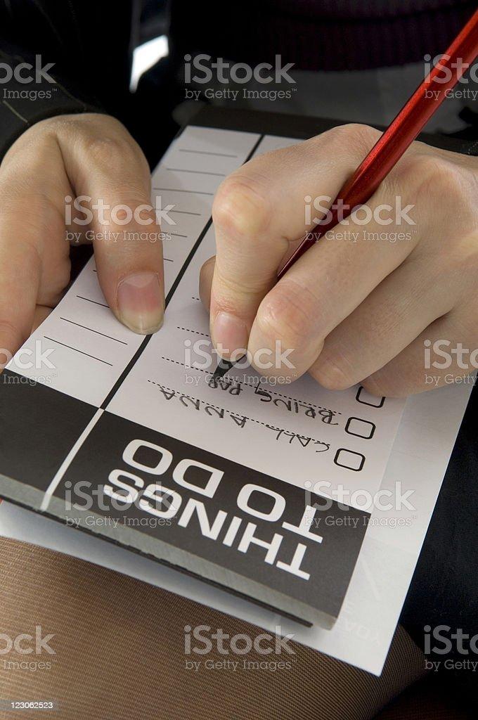 Businesswoman writing royalty-free stock photo