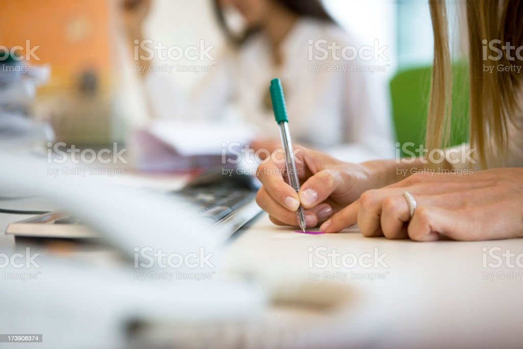Businesswoman writing stock photo