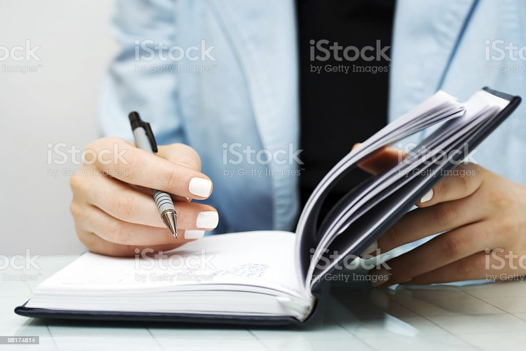 Businesswoman writing royalty-free stock photo