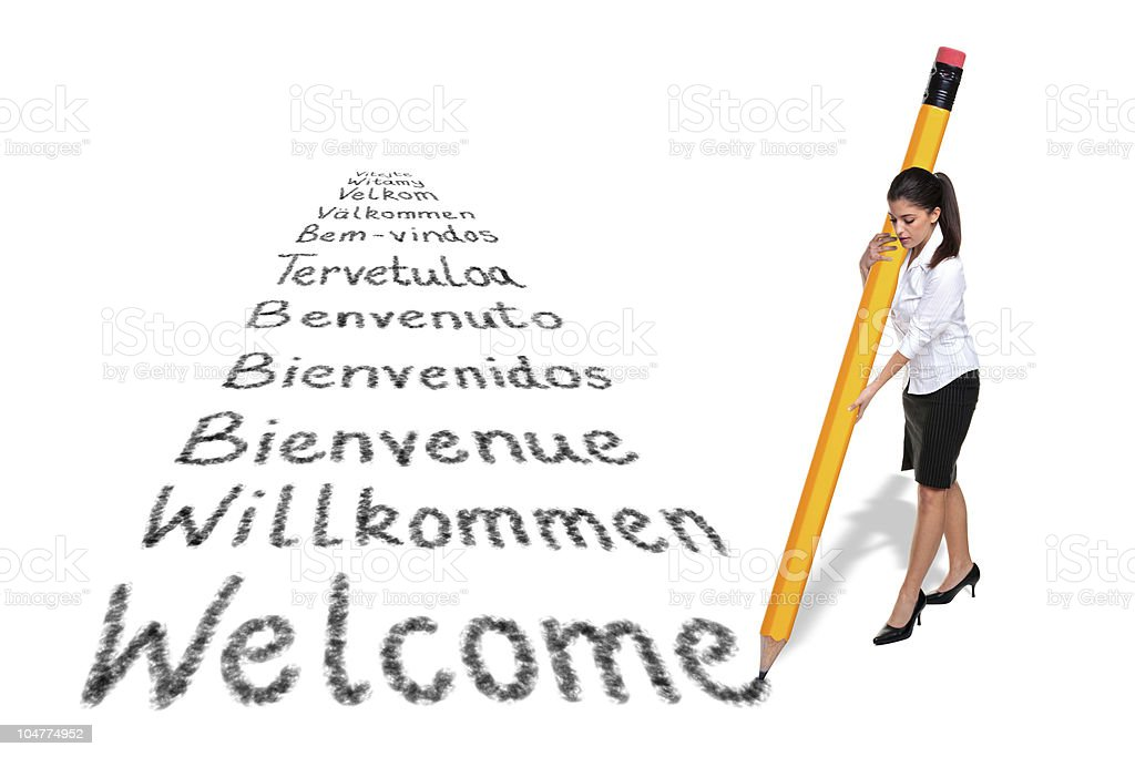 Businesswoman writing Welcome in various languages with a giant stock photo