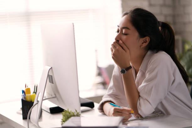 businesswoman, yawned she was tired of working in an office. - exhaustion stock pictures, royalty-free photos & images